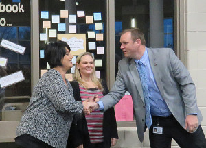 Superintendent Adrian Howie at right congratulates Melisa Norton at far left for winning the Eagle Impact award for March. Center Chrissy Lacy was also nominated for the award.