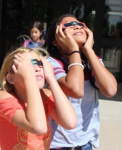 Hugoton Elementary students carefully use their approved solar eclipse viewing glasses to observe Monday's phenomenal event. Photo courtesy of Hugoton USD 210.