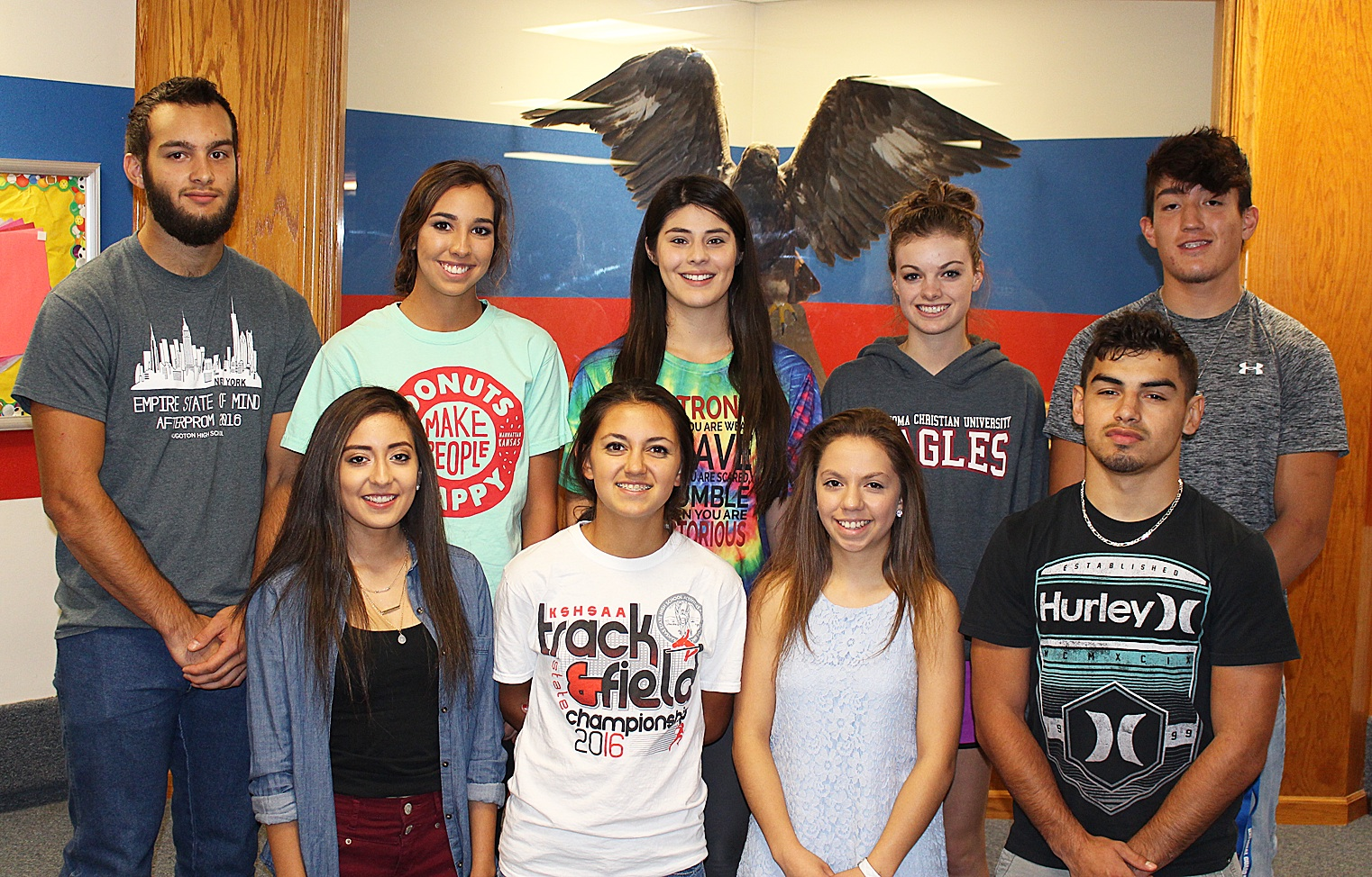 Homecoming 2016 is October 7! HHS is proud to announce the 2016 Football Homecoming Court. Front row left to right are Freshman Attendant Faith Degollado, Sophomore Attendant Abby Heger, Junior Attendant Madison Shuck, and Senior King Candidate Pedro Ordonez. In back are Senior King Candidate Romano Burger, Senior Queen Candidates Katy Heger, Melissa Fabela and Amy Scott, and Senior King Candidate Valentino Degollado. Not pictured are flower girl Brinlee Austin, daughter of Marie and Brian Austin and crown bearer Rowan Sullivan, son of Megan and Abel Sullivan. The coronation ceremony will be at 6:00 p.m. Friday prior to the kick off at 7:00 p.m. Congratulations to all! Photo courtesy of USD 210.