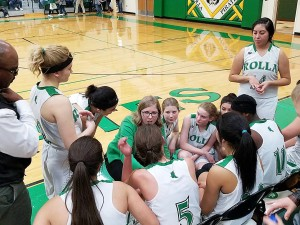 Rolla Junior High and High School competes against Deerfield last Friday. The girls catch a quick breather on the bench before going on to defeat the Spartans 41-27. The varsity boys narrowly won 49-48. Way to go Pirates!