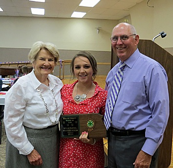 Pictured are Doug and Rita Mills receiving the Friend of 4-H Award from Adyson Gooch, 4-H Council President.