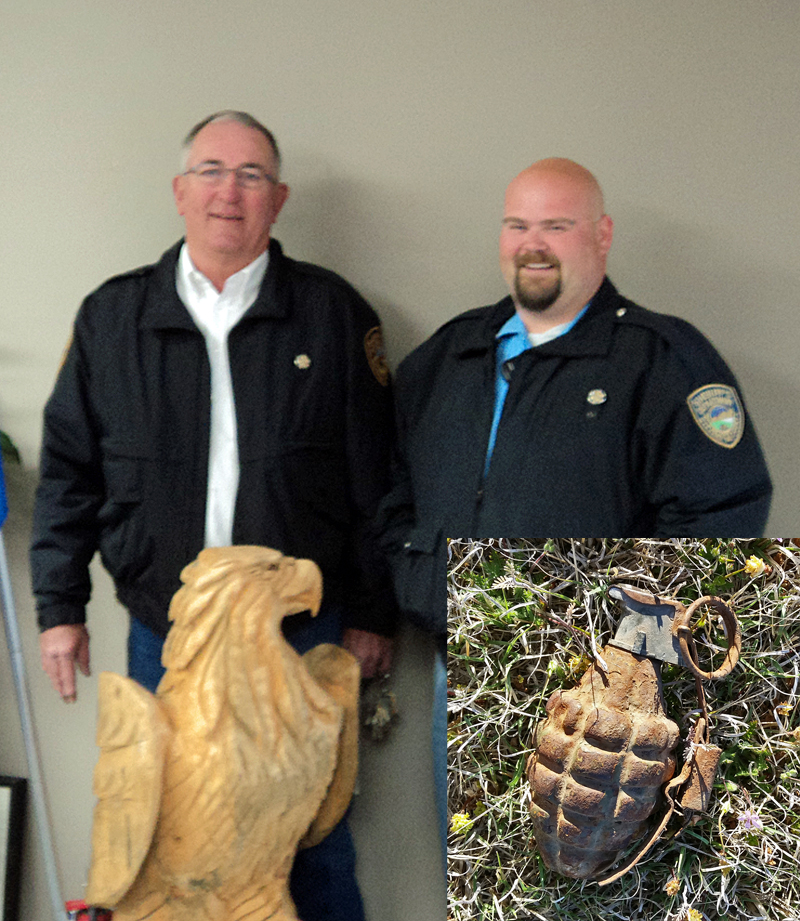 Sheriff Ted Heaton and Undersheriff T.J. Steers are pleased with a nonviolent outcome after disposing of the live grenade - seen at right of the picture here - found in Moscow last week.