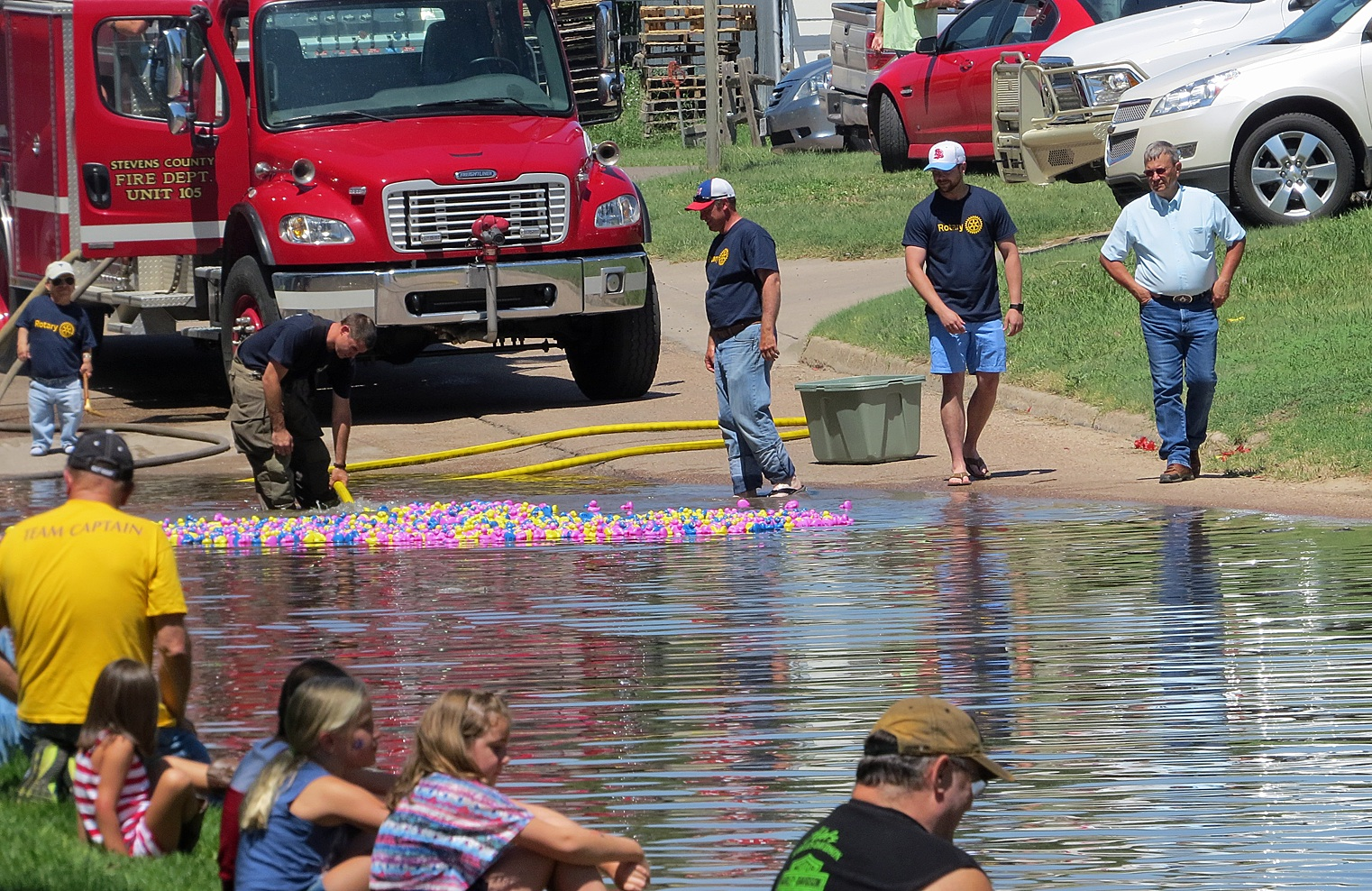 Townspeople line the 100 block of East Third Street while Hugoton Rotarians and Stevens County firefighters flood Canal Street for the Rotary's annual Duck Race. Ducks are sold for weeks before the event, and the highly anticipated race serves as a kind of finale for Hugoton's Park Day. Greg Soelter walked away the big winner, claiming the $1000 grand prize.