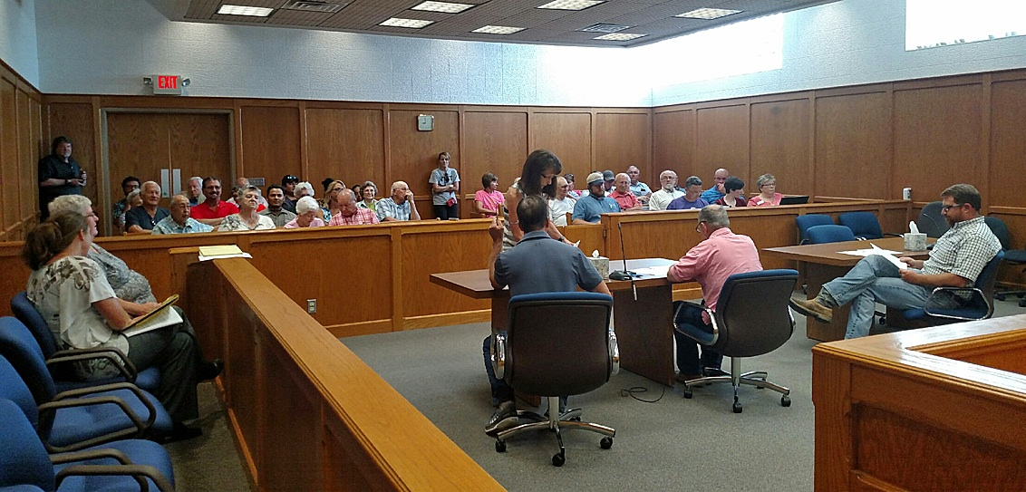 Commissioners listen to the many concerned citizens who came to lend their support for Robert Rich and Elaine Rowden with the  Fitness Center. They had to move their budget workshop upstairs to the courtroom Thursday to accommodate the large audience.