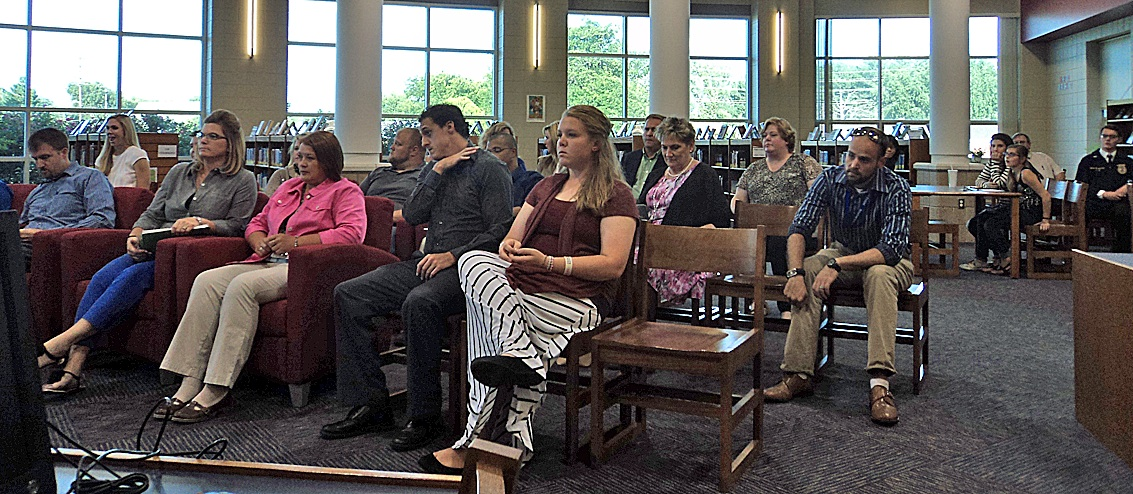 A large crowd attends the monthly meeting of the USD 210 Board of Education Monday night. New teachers, principals and several FFA members make up the audience. Building principals attended to introduce their new staff members to the school board.