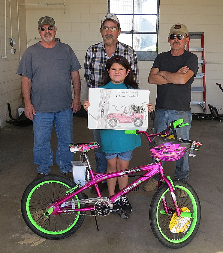 "Kayleigh Flores wins the statewide safety campaign poster contest ""Put the Brakes on Fatalities"" again.  She won last year also.   Employees of Kansas Department of Transportation stop by to offer their congratulations. Standing by her prize bike is Kayleigh, holding her winning poster.  Behind her, left to right are Sam Lowry, Kayleigh's dad Raul Flores and Curtis Haehn.  Congratulations Kayleigh!"
