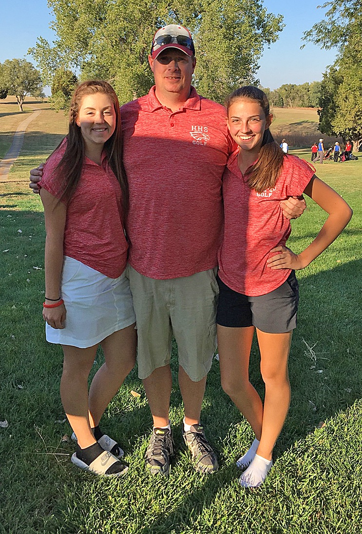 Mary Weaver and Brionna Beard proudly pose with Girls' Golf Coach Rex Evans. The two girls will be heading to State Golf in Garden City next Monday. Photo courtesy of Hallie Wettstein.