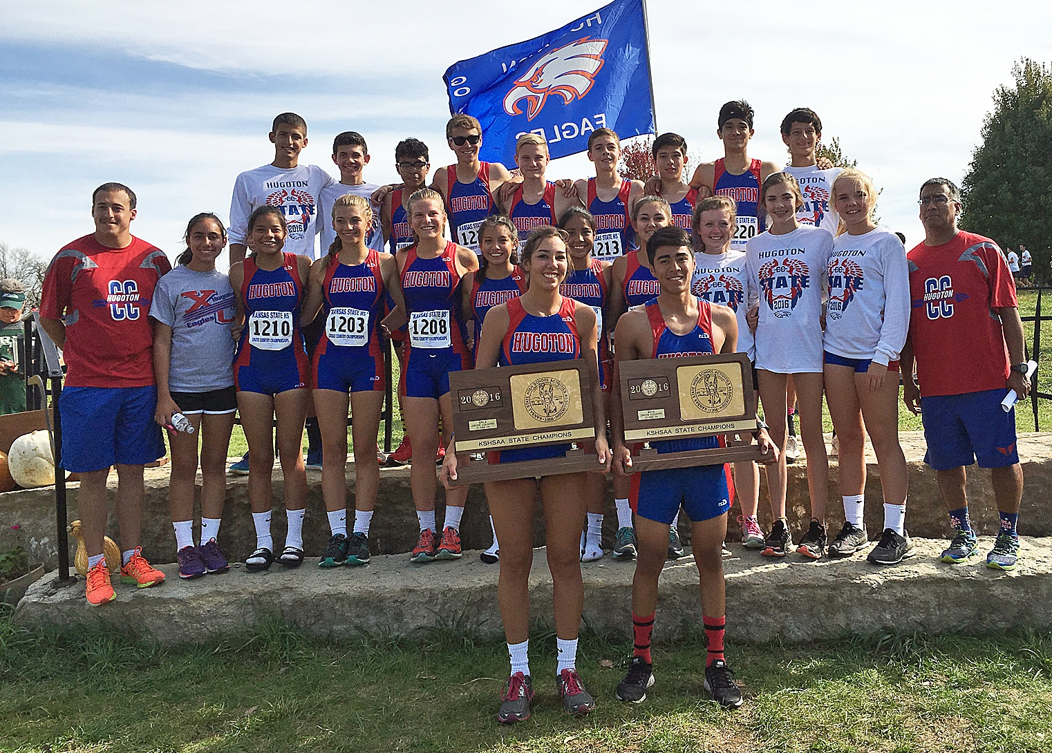 Hugoton High School's cross country teams celebrate their incredible victory at the State meet this past Saturday, October 29 at Rim Rock Farms in Lawrence. The boys' team won first with three top ten finishers: Miguel Martinez in third, Abraham  Garcia in fourth and Ethan Fox in ninth. For the girls' side, Abby Heger raced to a sixth place finish to place in the top ten for HHS. Coaches Nick Rodriguez and Nik Barre report the team executed their race plans perfectly and the staff was very proud of their accomplishments this season: GWAC League Champions, Regional Champions, and now 3A State  Champions! Team members include: holding the trophies, Katy Heger and Miguel Martinez; front row, Coach Nik Barre, Kara Rodriguez, Luz Romo, Frances Gaskill, Rebecca Johnson, Cielo  Garcia, Victoria Duran, Abby Heger, Hanna Coziah, Breckyn Hertel, McKnzie Hagman and Coach Nick Rodriguez; back row, Rodrigo Sanchez, Jorge Encinez, Bryan Gonzales, Eric Perry, Ethan Fox, Abraham Garcia, Jahaziel Garcia, Ivan Villa and Damian Lewis. Congratulations to Hugoton's most awesome HHS Cross Country Team!