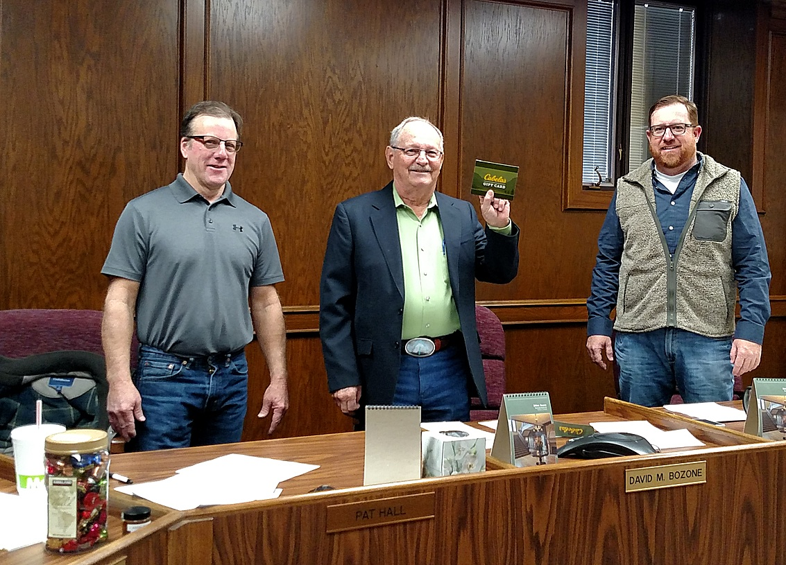 Retiring Stevens County Commissioner David Bozone proudly accepts his Cabelas gift card as a token of appreciation for his 16 years of service to the county. He is flanked by fellow Commissioners Pat Hall and Joe D. Thompson Tuesday morning during Dave's last meeting.