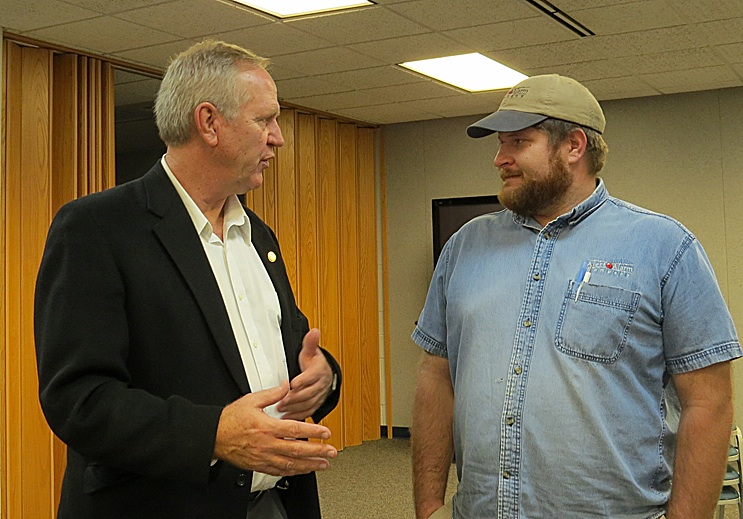 Kansas Senator John Doll speaks with local small business owner Curtis Crawford following 2017's first Legislative Update at the Stevens County Library.