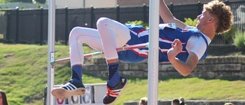 "Tony Kinser shimmies over the bar to earn a 3A State Championship in the High Jump. Kinser's jump of 6'8"" tied with the best jumps from classes 4A through 6A, and beat the rest of the 3A class competitors by four inches. Photo  courtesy of Greg O'Loughlin."